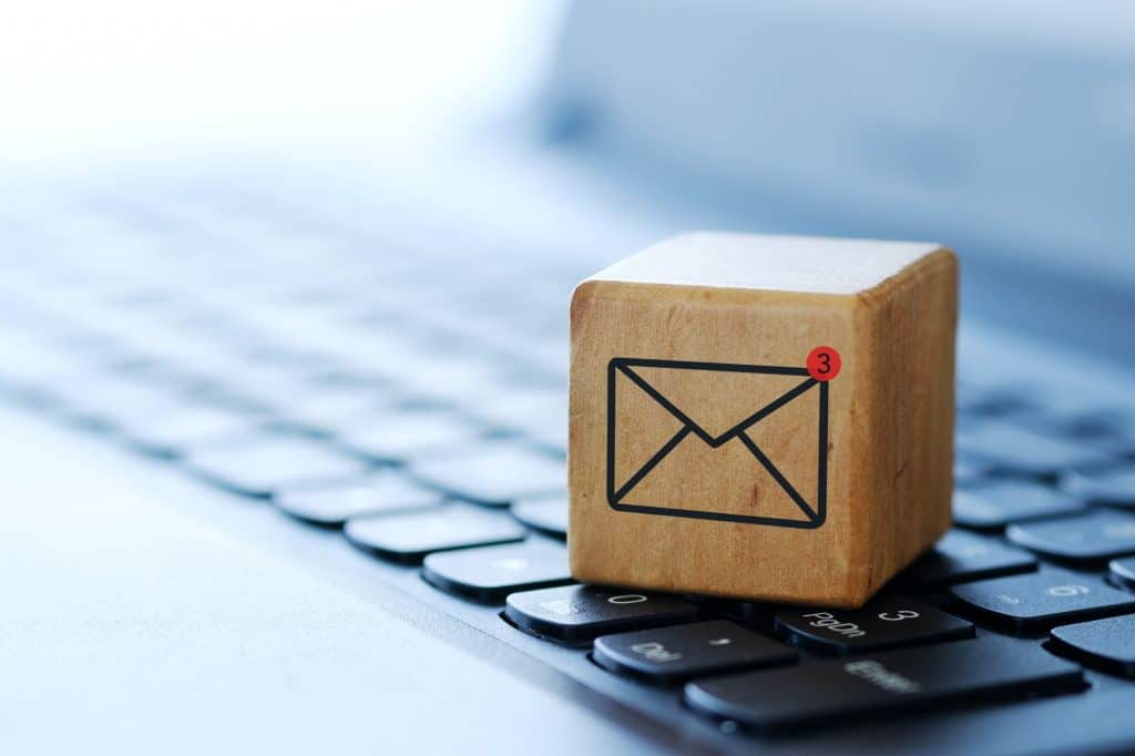 An envelope symbol on a wooden cube on a computer keyboard
